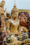 Wooden Buddha. Wood carvings of ancient Buddhist statue Stock Image