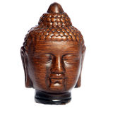Wooden Buddha head carving Stock Images
