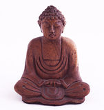 Wooden Buddha. Indonesia. Wooden Buddha belosm isolated background. Meditates raslabenno hands clasped Stock Photography