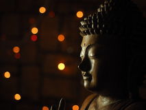 Wooden Buddha in Low Key light Stock Photos