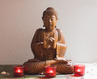 Wooden buddha in meditation stock images