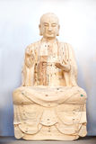 Wooden Buddha praying Royalty Free Stock Images