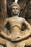 Wooden buddha statue Stock Image