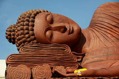 Wooden Buddha statue, with eyes closed Royalty Free Stock Photo