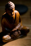 Wooden buddha statue on table Stock Image