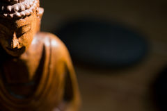 Wooden buddha statue on table Stock Photo