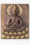 Wooden buddha Stock Image