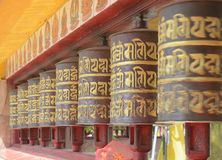 The wooden buddhist prayer wheels carrying buddhist mantras. Buddhist people chant mantra and rotates these prayer wheels in a clockwise direction. These wheels stock image