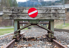 Wooden buffer stop concept. Wooden buffer stop with red stop sign ending rail tracks concept for limit, limitation restrication boundary, prohibited, end Stock Images