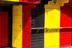 Wooden building with Belgium and Germany flag colors. Wooden building with combination of Belgium Belgien and Germany Deutschland flag colors: black, red, yellow royalty free stock images