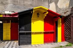 Wooden building with Belgium and Germany flag colors. Wooden building with combination of Belgium Belgien and Germany Deutschland flag colors: black, red, yellow royalty free stock photos