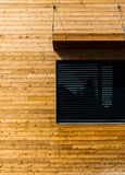 Wooden building with black window modern architecture royalty free stock photos