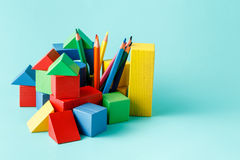 Wooden building block and colored pencils Royalty Free Stock Images