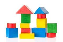 Wooden building blocks for kids on white background. stock photo