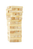 Wooden building blocks tower. On white background royalty free stock photos