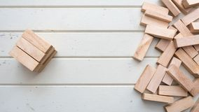 Wooden Building Blocks and wooden spread top view. Wood background stock photo