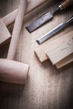 Wooden building boards hammers flat chisels on wood background c Royalty Free Stock Image