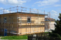 Wooden building. Construction of a new wooden house going ahead Stock Photography