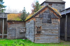 Fort Edmonton, Alberta, Canada. Historical wooden building with grass growing on roof at Fort Edmonton, Alberta, Canada royalty free stock image