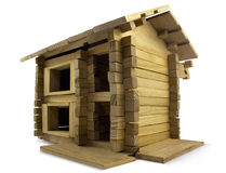 Wooden building. Isolated wooden toy cottage angle view Royalty Free Stock Images