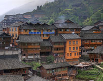 Wooden building rural hotels in Chinese village of ethnic minori Stock Image