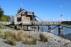 Wooden building on shore Lake Te Anau New Zealand. View of wooden building on shore Lake Te Anau with access to jetty out on to the lake, Te Anau, Southland Stock Photography
