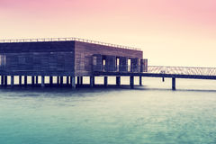 The wooden building on stilts over Lake Constance. The wooden building on stilts over Lake Constance at dusk Royalty Free Stock Image