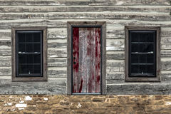 Wooden building on stone foundation Stock Photo