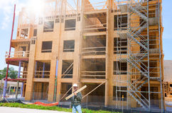 Wooden building under construction with worker Stock Photo