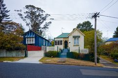 Wooden buildings in an Australian suburb. Old picturesque wooden houses in a green Australian suburb. Village street in a small town in New South Wales Australia royalty free stock photos