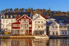 Wooden buildings shops and restaurants along the shore Stock Image