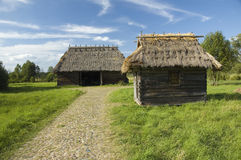 Wooden buildings with thatched roofs Royalty Free Stock Photos