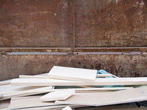 Wooden bulky waste in a rusty container Stock Photography
