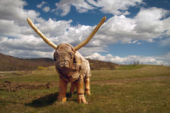 Wooden bull. Wooden sculptures of life-size bull outdoors in Zlatibor Royalty Free Stock Photography