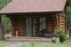 Wooden bungalow row in camping camp park in mountains. Wooden bungalow row in camping camp park stock image