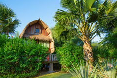 Wooden bungalow on a tropical beach resort on Bali Royalty Free Stock Photo