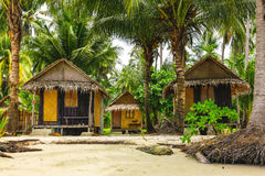 Wooden bungalows in tropic forest Stock Photography
