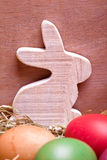 Wooden bunny and colorful easter eggs Stock Image