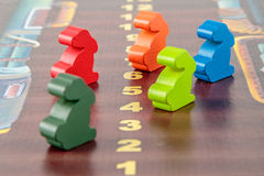 Wooden bunny pieces on a board game Stock Photo
