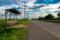 Wooden bus stop. And the road Royalty Free Stock Images