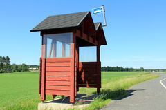Wooden Bus Stop Shelter by Highway Stock Photos