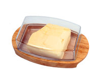 Wooden butter dish Stock Images