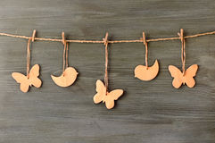 Wooden butterflies and birds on a string Stock Image