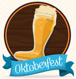 Wooden Button with Beer Boot for Oktoberfest Celebration, Vector Illustration. Wooden tap of a keg with beer boot and a blue ribbon commemorating Oktoberfest Royalty Free Stock Photo