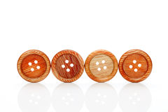 Wooden buttons. On a white background Royalty Free Stock Photos