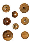 Wooden Buttons. Eight vintage wooden buttons on a white background Royalty Free Stock Photography