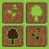 Wooden buttons with ecological icons of leaves and Stock Photo