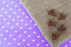 Wooden buttons hearts on sackcloth with space for text Wooden buttons hearts on sackcloth with space for text Royalty Free Stock Photo