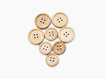 Wooden buttons. Lie on a white background Royalty Free Stock Photos