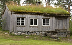 Wooden cabin. Old wooden mountain cabin with turf roof Stock Photo